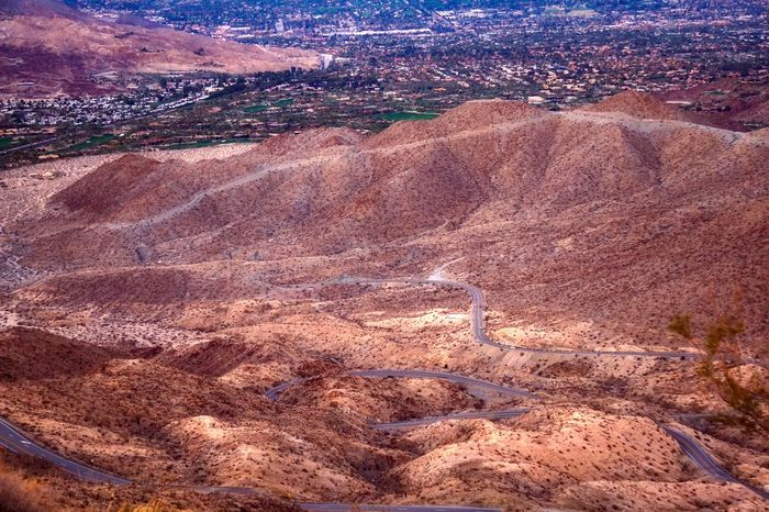 View of curvy Highway 74 from viewpoint above Palm Desert Curves Highway 74 Palm Desert, CA Road View Arid Climate Barren Beauty In Nature Day High Angle View Highway Landscape Nature No People Outdoors Scenics Serpentine Tranquility Travel Destinations
