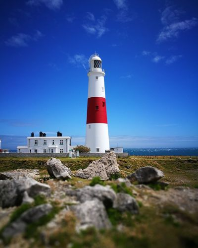 Portland lighthouse Dorset Lighthouse Beach Sea Day Direction Sky Water's Edge Outdoors Horizon Over Water Nature Water No People Clear Sky Sand Dune Building Exterior Tower Lighthouse Blue Landscape Clear Sky Nature Grass Rock First Eyeem Photo Flower