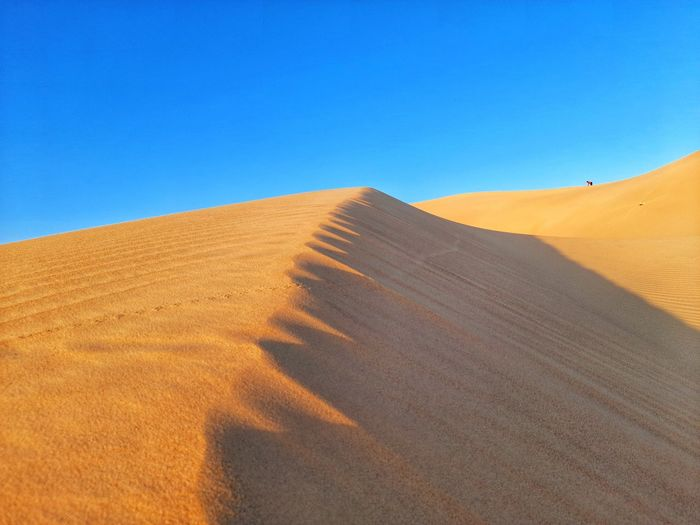 Hill of sand dunes on desert