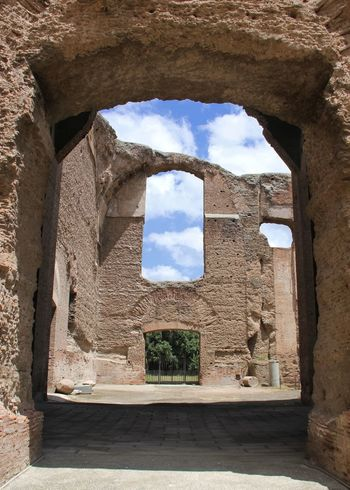 Built Structure Sky Arch Cloud - Sky Building Exterior Day History No People Outdoors Ancient Civilization Italy Therme Di Caracalla Tourism Roman Ruins Tranquil Place Archeological Site Ruin Broken Window In The Sky Window Ancient Travel Destinations Incomplete Archeology Miles Away