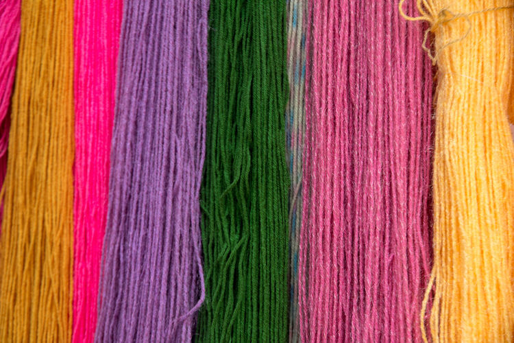 Colourful wool string Art And Craft Backgrounds Choice Close-up Craft Creativity Full Frame Indoors  Industry Man Made Man Made Object Material Multi Colored No People Pattern Purple Silk Softness Textile Thread Variation Wool