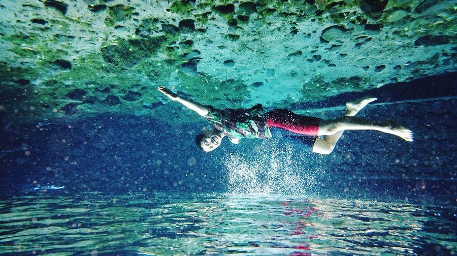 Man swimming in water