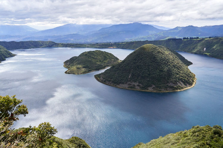 Laguna Cuicocha (Guinea Pig Lake) is a spectacular sight in person Laguna Lakeview Vista Beauty In Nature Crater Cuicocha Day Geology Lake Landscape Mountain Nature No People Outdoors Physical Geography Scenics Sky Tourism Tranquil Scene Tranquility Tree Vacation Destination Wallpaper Water Perspectives On Nature This Is Latin America