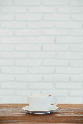single coffee cup on wooden table Close-up Coffee - Drink Coffee Cup Cup Day Drink Food And Drink Freshness Indoors  No People Refreshment Saucer Table Tea - Hot Drink