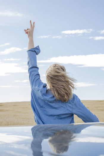 Arms Raised Beach Beauty In Nature Cloud - Sky Day Hair Hairstyle Horizon Over Water Human Arm Land Leisure Activity Lifestyles Nature One Person Outdoors Real People Rear View Scenics - Nature Sea Sky Water Women