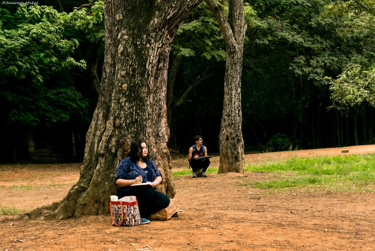 Let's sketch it perfect Beauty In Nature Branch Casual Clothing Drawing Fine Art Fineart Green Color Indian Learning Leisure Activity Lifestyles Nature Non-urban Scene Park - Man Made Space Person Portrait Photography Sketching Togetherness Tranquility Tree Tree Trunk Treelined Vacations