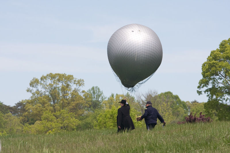Balloon For Photography Beauty In Nature Civil War Re-enactments Civil War Ruins Day Grass Green Color Growth Leisure Activity Lifestyles Men Nature Person Photoraphy Rear View Reenactment Scenics Sky Togetherness Tranquil Scene Tranquility Tree