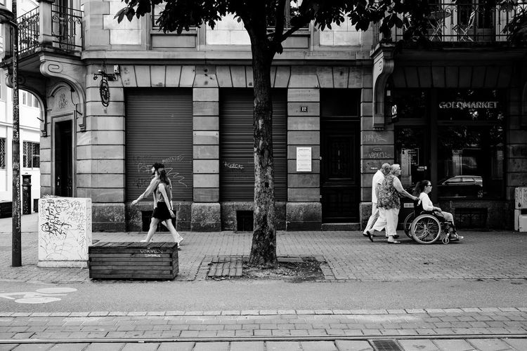 People passing by ... Urban Perspectives Street Photography Black & White The Devil's In The Detail Walking Around Black And White Monochrome Building Exterior Architecture Real People Built Structure City Street Transportation Full Length Footpath Lifestyles People Men Mode Of Transportation Adult Day Women Sidewalk Building Walking The Street Photographer - 2019 EyeEm Awards