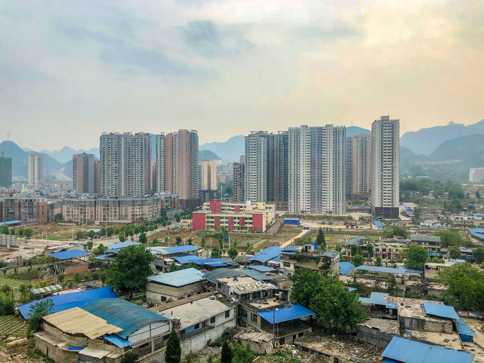 View of Zhiangjiazhai City,, Northwest China, with the mountains of Inner Mongolia in the background Building Exterior Built Structure City Cityscape Mountain Range No People Residential District Skyscraper