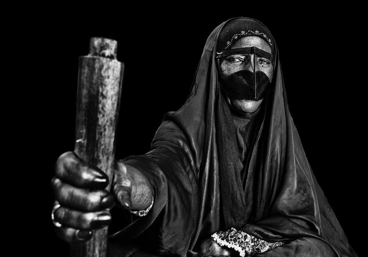Spooky Woman Wearing Mask Against Black Background