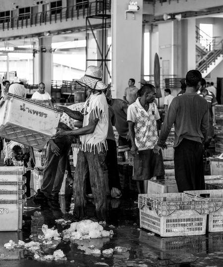 People standing on street market in city