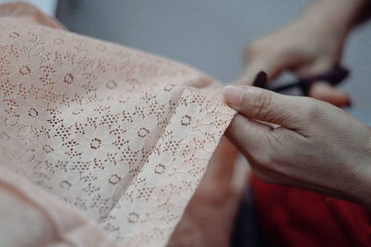 Cropped image of woman cutting fabric