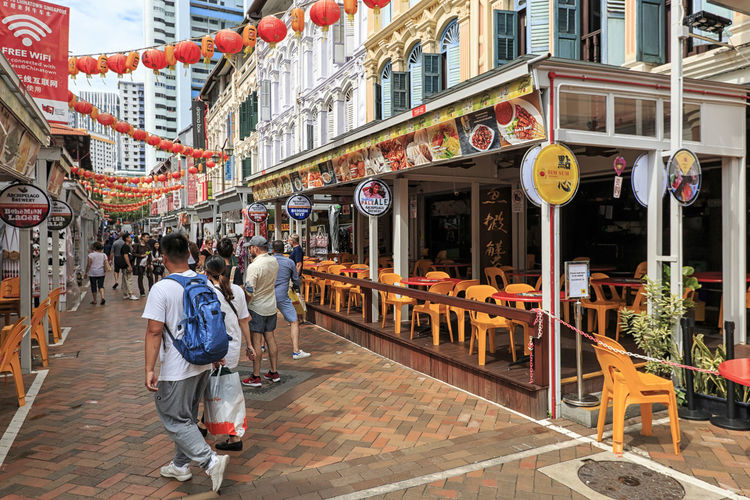 Singapore, Singapore - October 18, 2018: Tourists walking in Haji Lane near the Arab area in Kampong Glam Singapore Marina Bay Sands Merlion Haji Lane, Singapore Arab Street Cityscape Modern Art Museum Buddah Tooth Relic Temple Kampong Glam