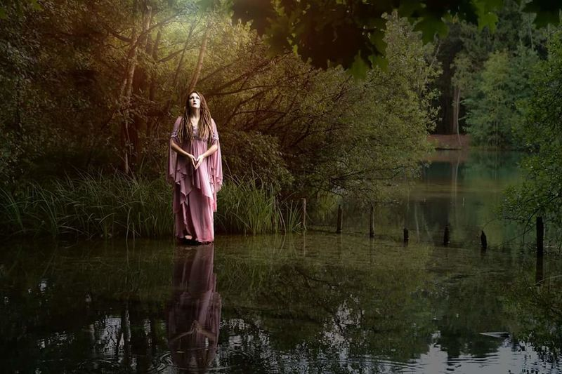 Water Reflection Lake Adult Tree Nature People Outdoors Full Length Standing Day Young Women Phantasy Photography Beautiful People Beautiful Available Light Photography Picture Of The Day Beauty In Nature Check This Out Portrait Girls Women Beautiful Woman Long Hair One Woman Only dreadlocks