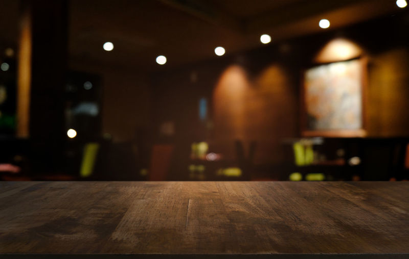 Empty dark wooden table in front of abstract blurred bokeh background of restaurant . can be used for display or montage your products.Mock up for space Top Background Wooden Empty Display Table Wood Design Interior Desk Product Dark Space Kitchen Room Bokeh Abstract Old Texture Cafe Surface Wall Backdrop Vintage Blur Retro Restaurant Coffee Tabletop Counter Board Black Blurred Plank Template Shop Night Light Advertise Place Decoration Blank Brown Food Rustic Montage Perspective Business Modern Bar Illuminated Indoors  No People Wood - Material Focus On Foreground Lighting Equipment Absence Flooring Seat Ceiling