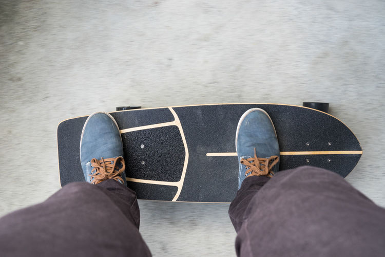 just skate Balance Blue Shoes Canvas Shoe Carver Directly Above Foreward Grip High Angle View Jeans Legs Lifestyles Longboard Move Outdoors Personal Perspective Shoe Shoes Skate Skate Street Skateboard Skateboarding Skatelife Standing Street