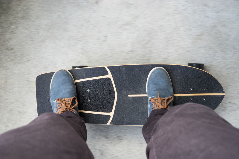 just skate Balance Blue Shoes Canvas Shoe Carver Directly Above Foreward Grip High Angle View Jeans Legs Lifestyles Longboard Move Outdoors Personal Perspective Shoe Shoes Skate Skate Street Skateboard Skateboarding Skatelife Standing Street Focus On The Story