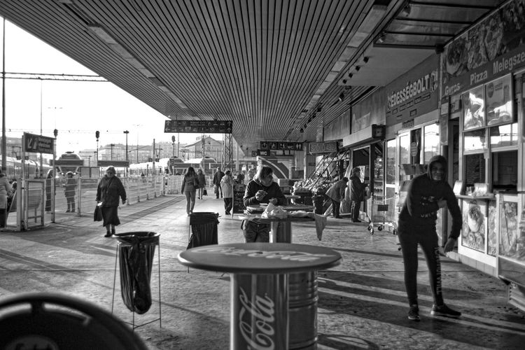 Black & White Blackandwhite Blackandwhite Photography Bw City Life Composition Contemporary Men Narrow Perspective Railroad Station Real People Retail  Streetphoto_bw Streetphotography Waiting Women