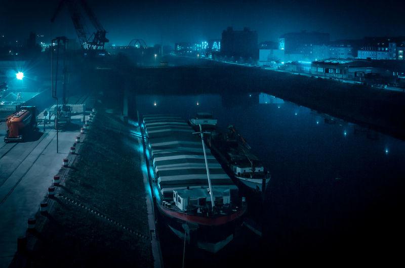 High angle view of illuminated bridge over sea at night