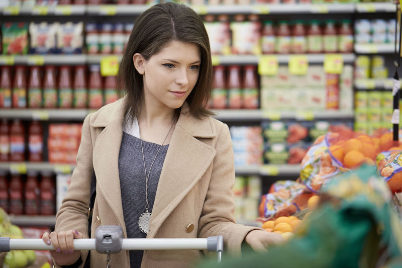 Woman Buying Food At Supermarket