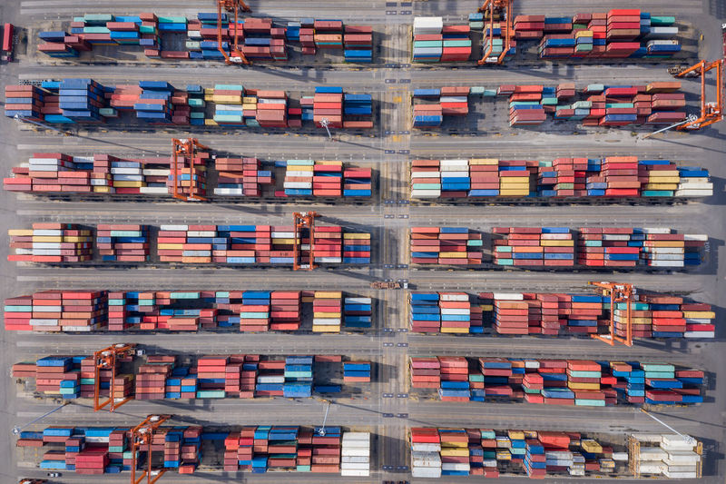 Aerial View Freight Transportation Architecture Container Transportation Multi Colored Business Industry Cargo Container In A Row Stack Full Frame Day Travel Organization Large Group Of Objects High Angle View Shipping  Travel Destinations Building Exterior No People Order Outdoors Cityscape Trucking