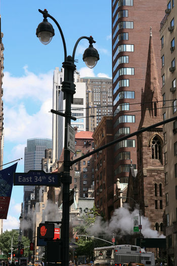 Smoking church 34th Street  Architecture Big Apple Building Exterior Church City City Life Crossroad Day Lamppost New York Road Sign Sky And Clouds Steam Street Traffic Lights Urban USA
