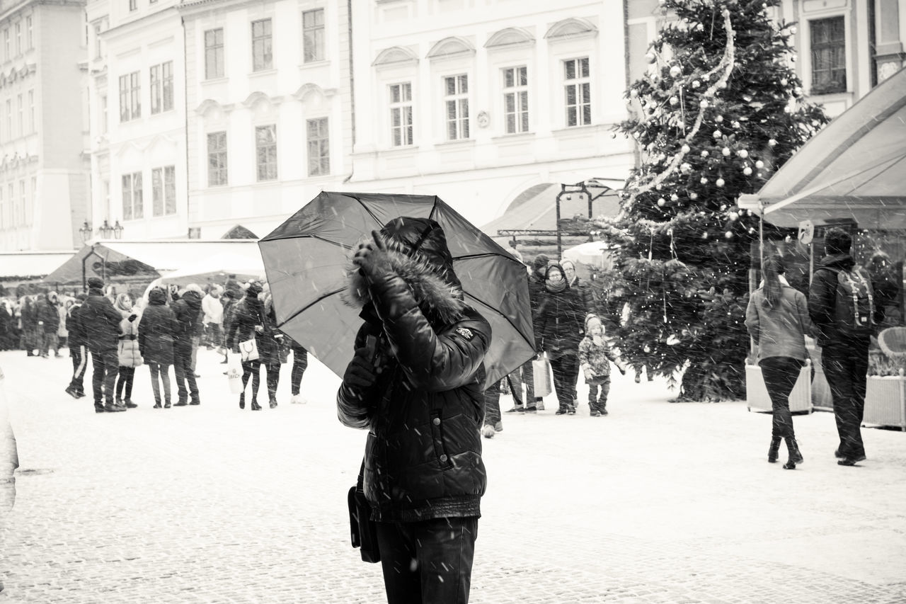 People walking on city street in winter during christmas