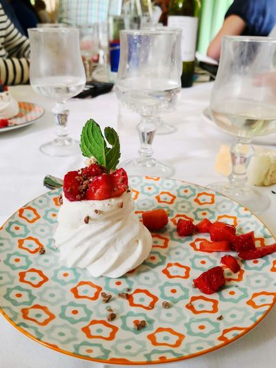 Strawberry Pavlova Cake Gourmet Dessert Plate Food Styling Frozen Food Table Celebration Dessert Topping Cake Drinking Glass Whipped Cream Cream Unhealthy Lifestyle