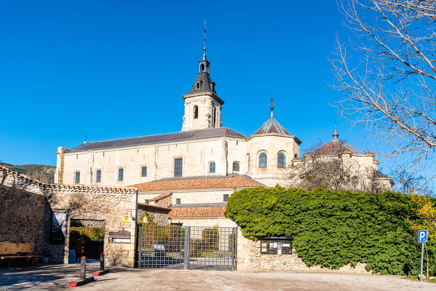 El Paular monastry in Madrid Architecture Building Exterior Built Structure Building Plant Tree Sky Religion Nature Place Of Worship Belief Clear Sky Blue Outdoors Church Rascafría Lozoya Madrid Mountain Landscape Monastry History The Past Travel Destinations City No People Spire