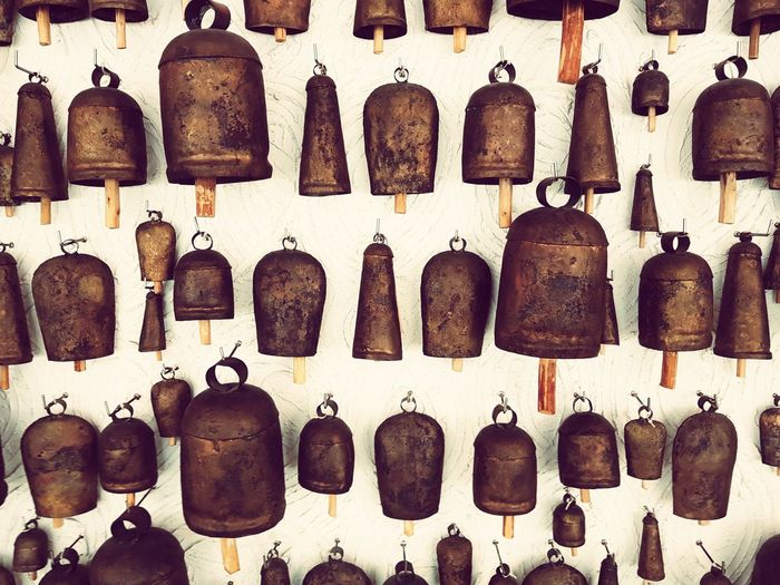 A collection of traditional bells hanging on a wall India Bells Traditional Traditional Art Full Frame No People Variation Close-up