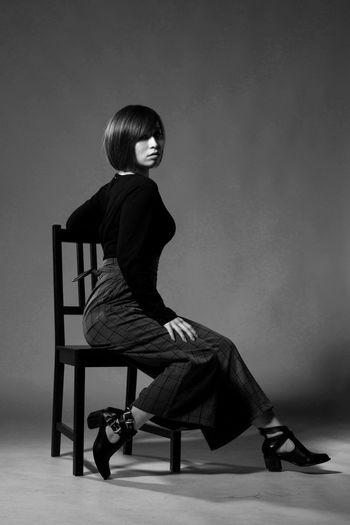 Beautiful Black & White Chair Fashion Sitting Beauty Girl Portrait, Women