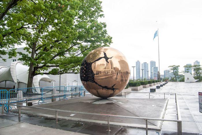 Arnaldo Pomodoro New York City Sphere Sphere Within A Sphere United Nations United Nations New York cloudy