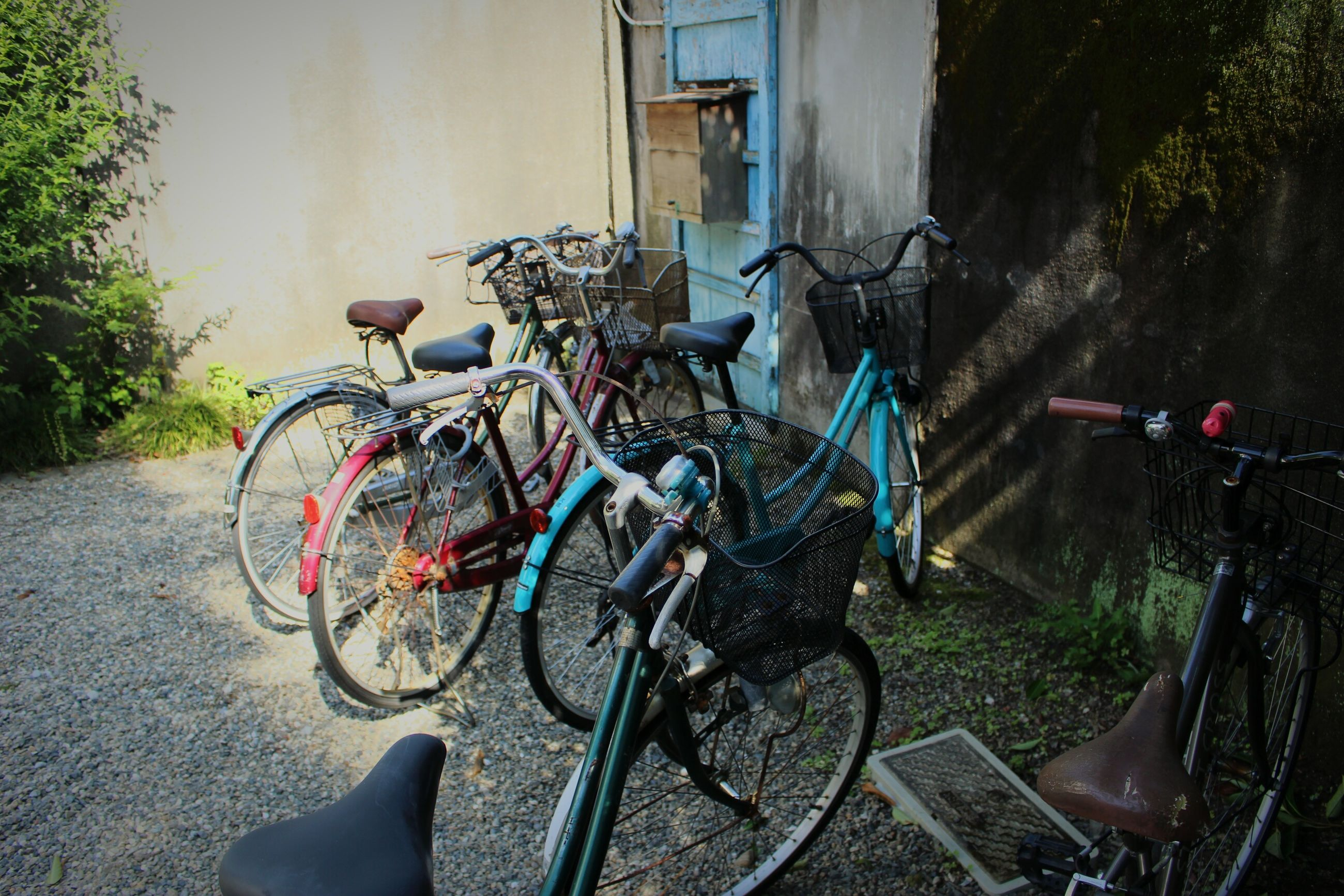 bicycle, mode of transport, land vehicle, stationary, transportation, no people, outdoors, bicycle rack, day