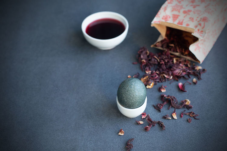Instructions how to color easter eggs with natural dye. grey color from carcade tea. copy space.