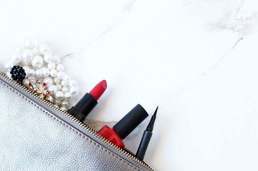 Party preparations Beautiful Beauty Chic Cosmetics Elegant Eyeliner Fashion Flat Lay Frame Glamour Make Up Make Up Bag Mock Up Open Your Eyes For Amnesty International Overhead View Pearls Purse Red Lipstick Red Nail Polish Rhinestones Spilled Style Styled Supplies Vintage