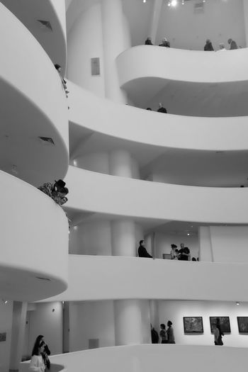 Low angle view of people in shopping mall