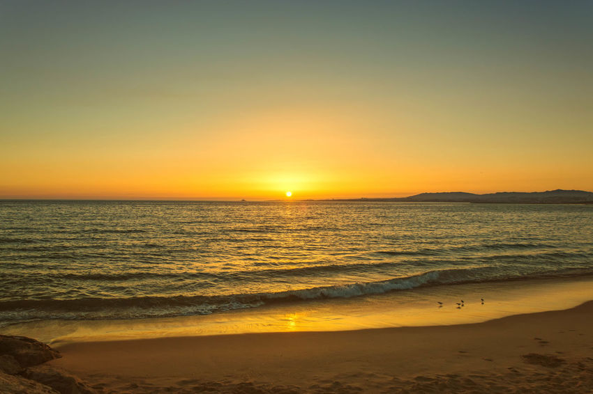Beach Beauty In Nature Clear Sky Costadecaparica Horizon Over Water Idyllic Nature No People Orange Color Outdoors Sand Scenics Sea Sky Summer Sun Sunlight Sunset Tranquil Scene Tranquility Travel Destinations Vacations Water Wave