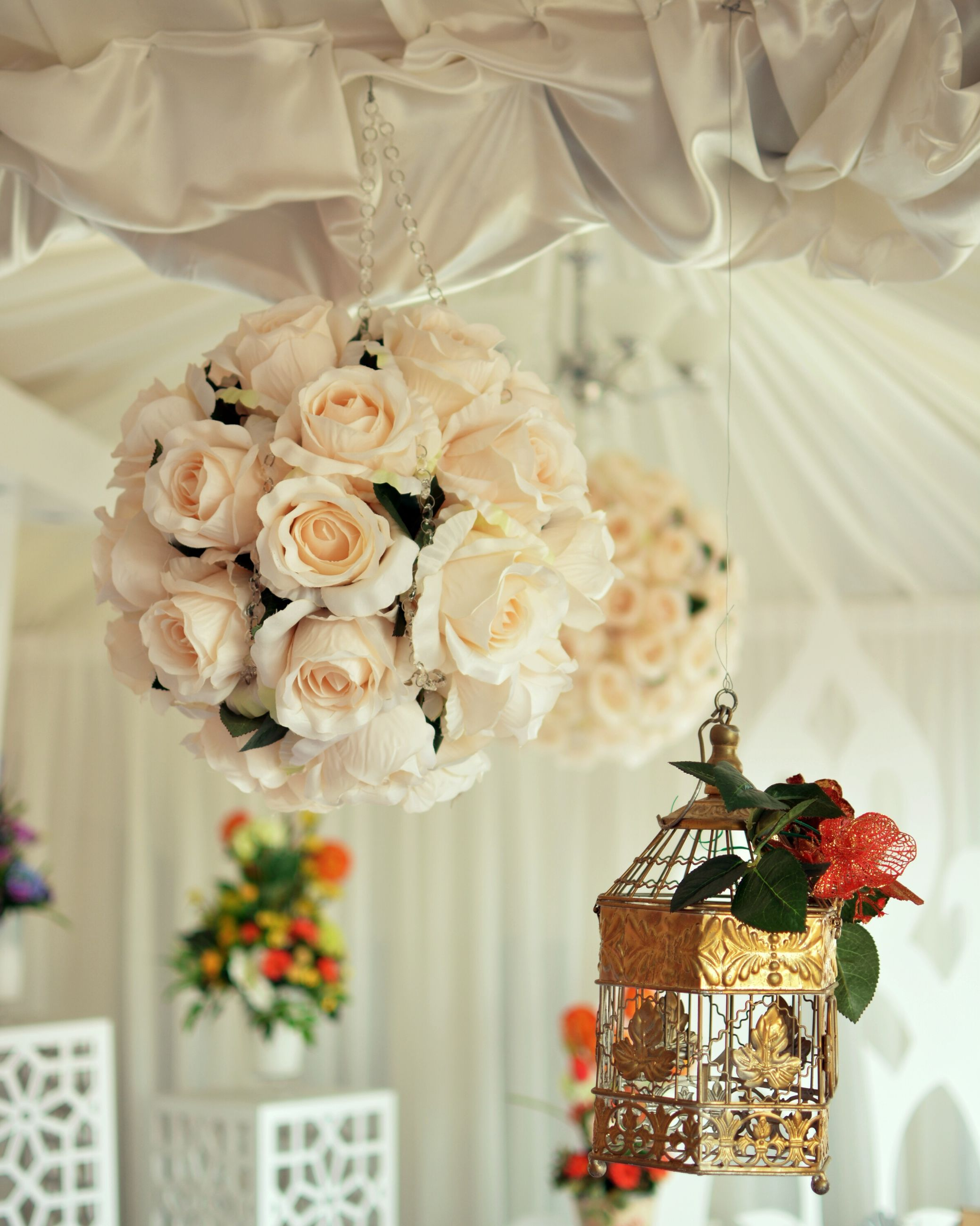 indoors, flower, decoration, close-up, focus on foreground, vase, hanging, white color, religion, selective focus, table, glass - material, fragility, still life, freshness, no people, home interior, art and craft, spirituality, ornate
