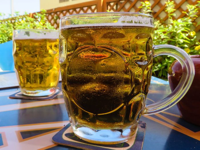 Pint Of Lager Alcohol Beer Beer - Alcohol Beer Glass Close-up Cold Temperature Day Drink Drinking Glass Food And Drink Freshness Frothy Drink Lager Mint Tea No People Outdoors Pint Of Beer Refreshment Table