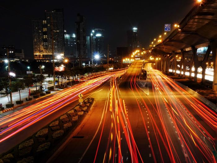Night Illuminated Light Trail Transportation City Long Exposure Speed Traffic Motion Street Light No People City Life Architecture Travel Destinations Built Structure Outdoors Rush Hour Tree Sky Cityscape