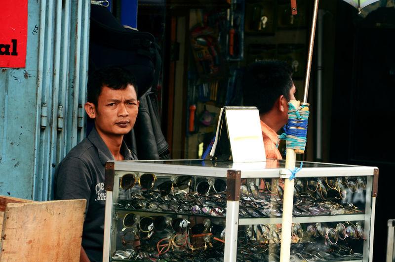 Portrait Of Man Selling Sunglasses In Market