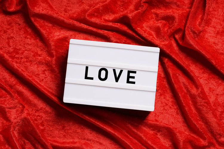 Love Text On Red Fabric