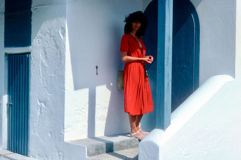 One Person Real People Architecture Leisure Activity Lifestyles Built Structure Full Length Casual Clothing Clothing Standing Young Women Women Young Adult Red Day Front View Staircase Dress Fashion Outdoors Hairstyle Contemplation Beautiful Woman Light And Shadow