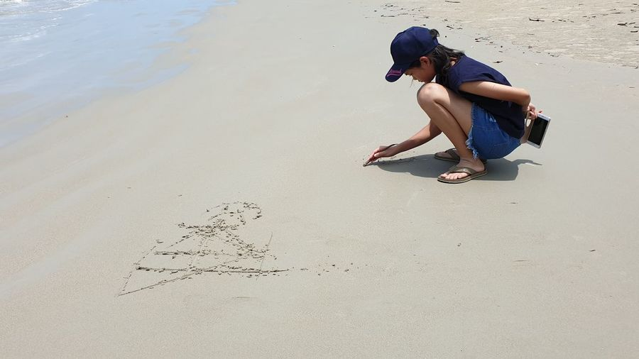 Girl On Sandy Beach Nature Girl Child Sitting Full Length Beach Sand Crouching Shore Horizon Over Water Ocean Sea Wave Water Sport Coast Coastline Seascape