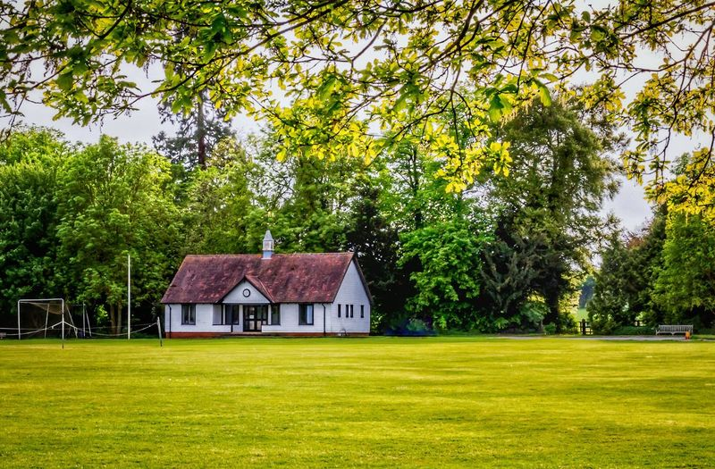 Rickling green EyeEm Selects The Great Outdoors - 2017 EyeEm Awards Cricket Field Plant Tree Grass Green Color Architecture Built Structure Building Exterior Building Nature Field Land Growth Day No People House Beauty In Nature Landscape Outdoors Sky Tranquility