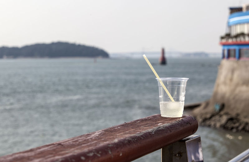Beverage Close-up Cup Day Drink Focus On Foreground Juice Lighhouse Nature No People Outdoors Sea Sea And Sky Seascape Selective Focus Soda Still Life Wolmido Wolmido Wood - Material Wooden Wooden Post