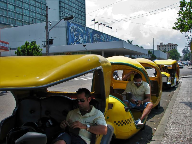 Coco Taxi Cuba Collection Havana Havana, Cuba Taxi Driver Travel Travel Photography Car City Havana Cuba Land Vehicle Mode Of Transport Real People Road Sitting Street Street Photography Streetphotography Taxi Tourist Destination Transportation Yellow Yellow Taxi