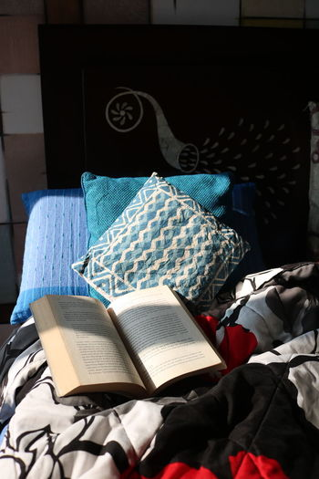 Open book on bed at home