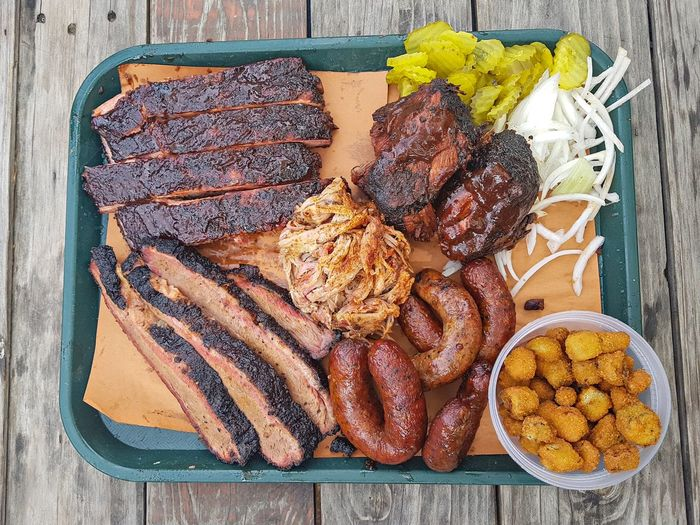 The Trough Pecan Lodge Deep Ellum Barbecue BBQ Pulledpork Bbq Ribs High Angle View Directly Above Table Food Food And Drink No People Freshness Food Stories