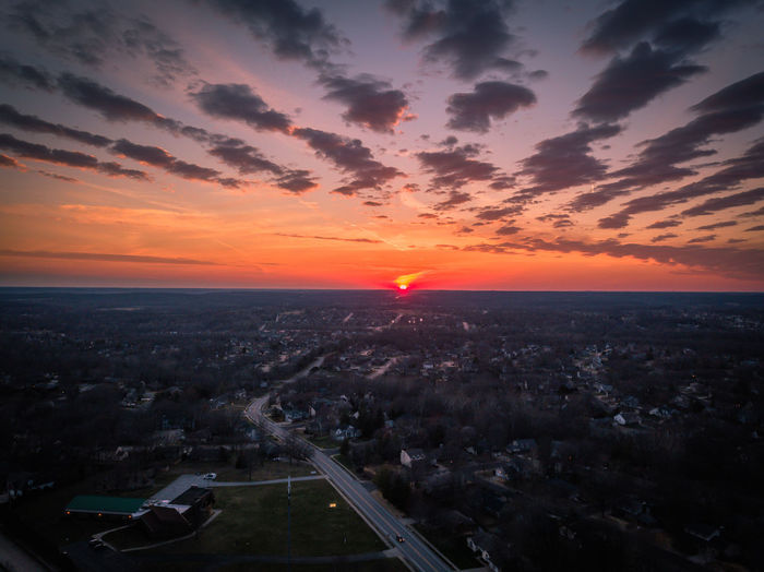 Aerial View Architecture Beauty In Nature Building Building Exterior Built Structure City Cityscape Cloud - Sky Environment High Angle View Horizon Horizon Over Water Nature No People Orange Color Outdoors Scenics - Nature Sky Sun Sunset
